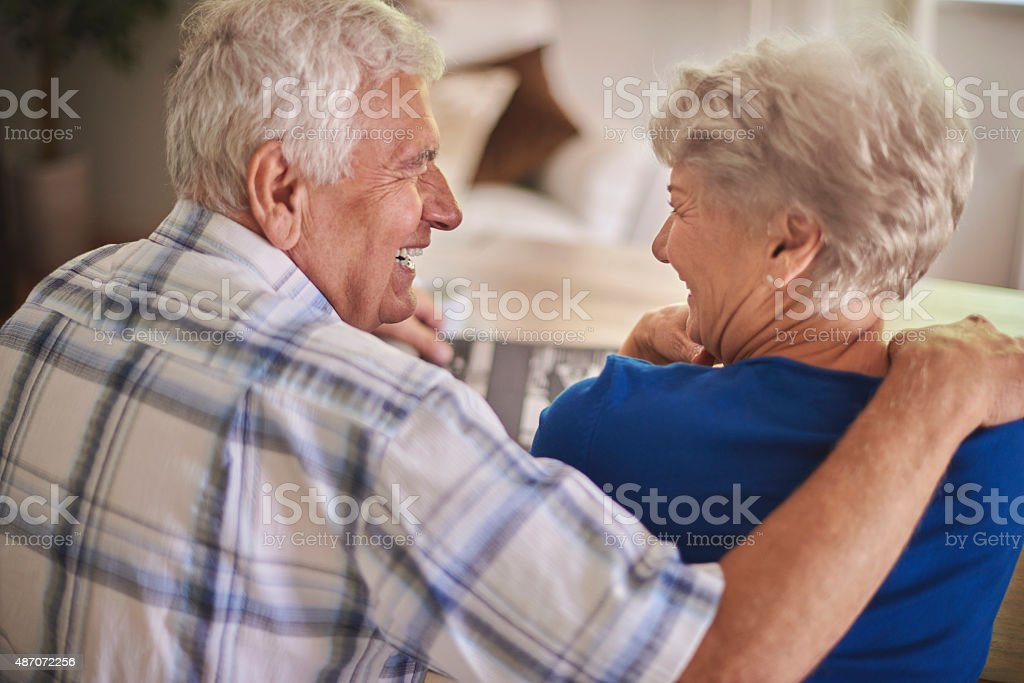 Senior couple reminisces good old times stock photo