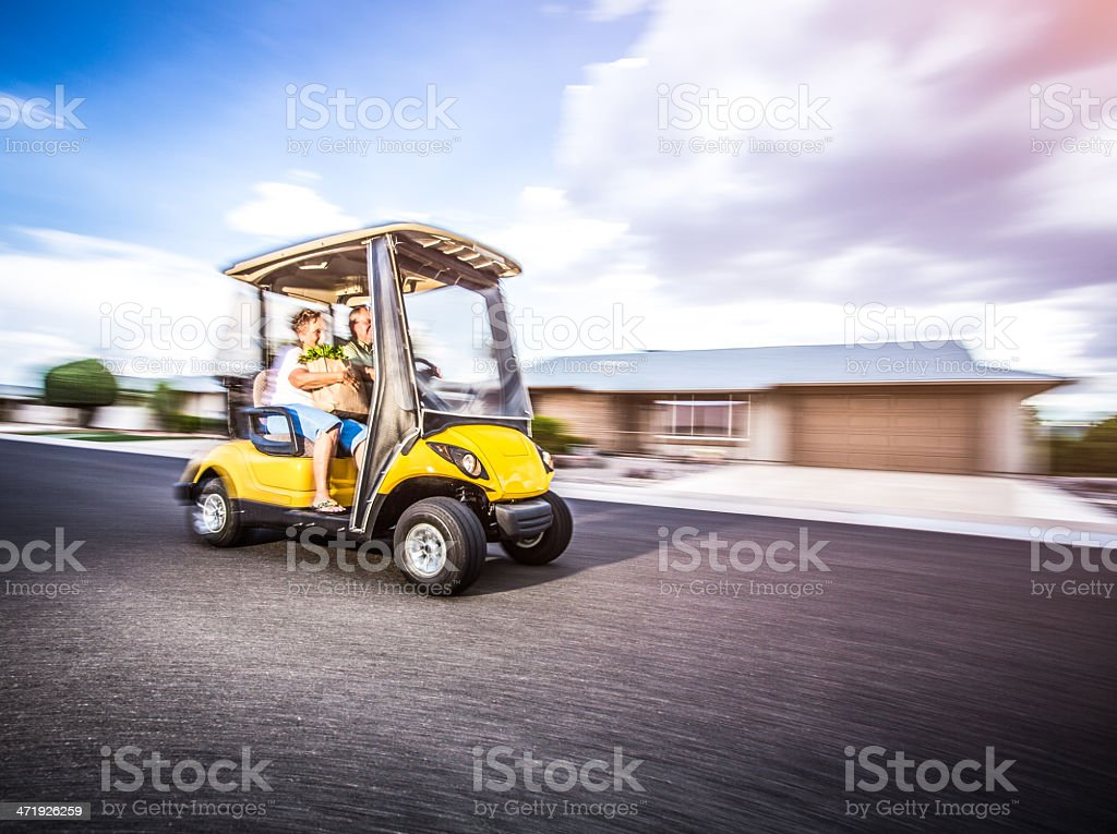 Senior couple returning home after shopping stock photo