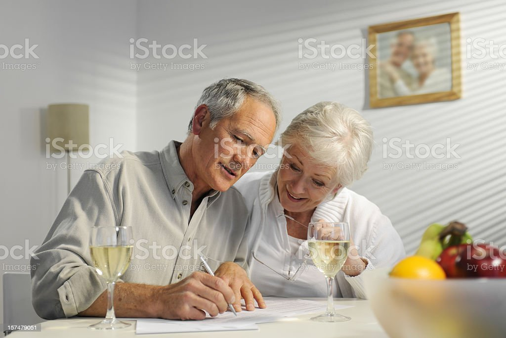 Senior couple reviewing paperwork royalty-free stock photo