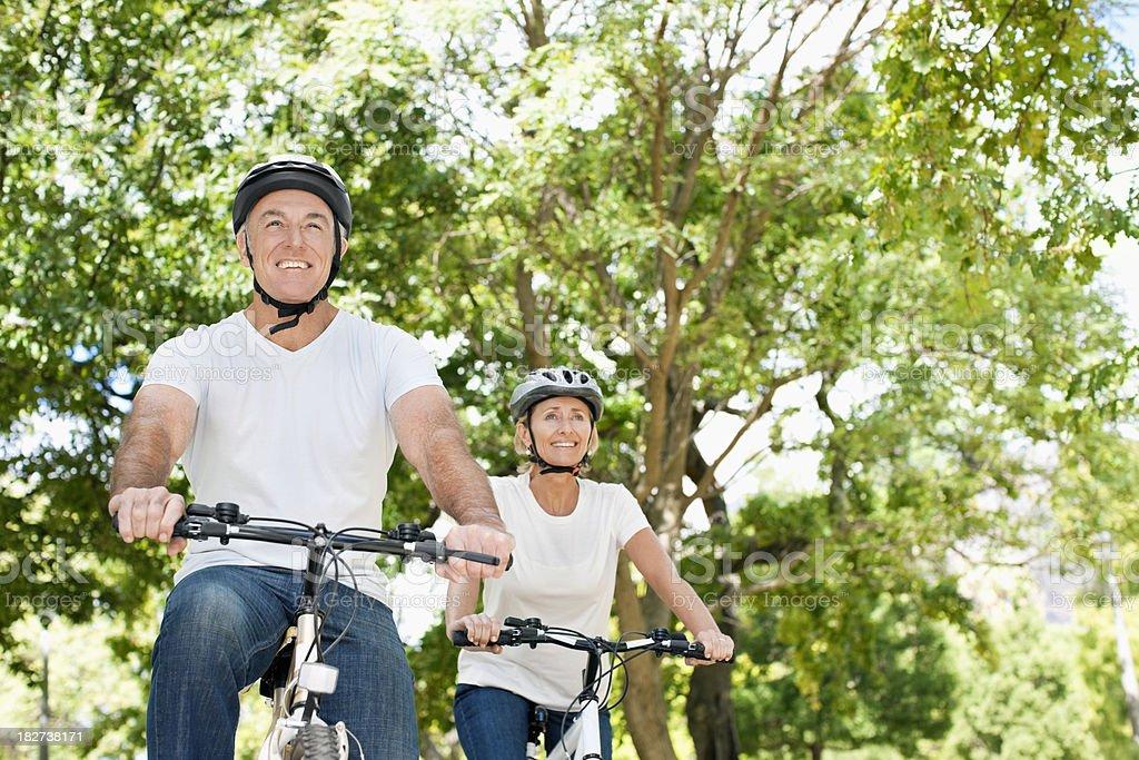 Senior Couple Riding Bikes royalty-free stock photo