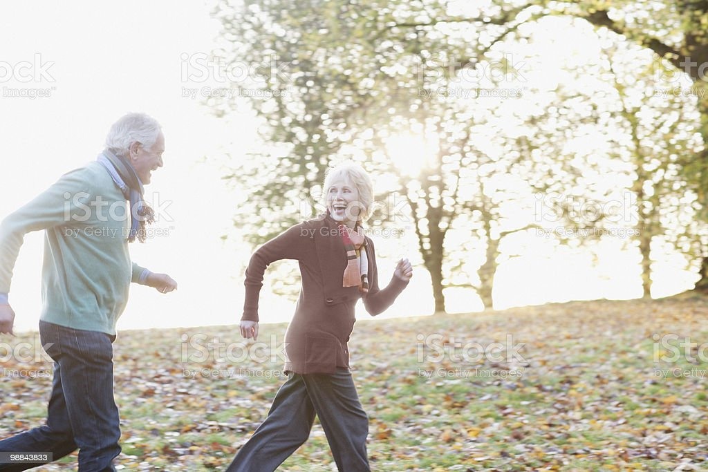 Senior couple running in park royalty-free stock photo