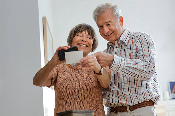 Senior Couple Sharing Old Photos stock photo