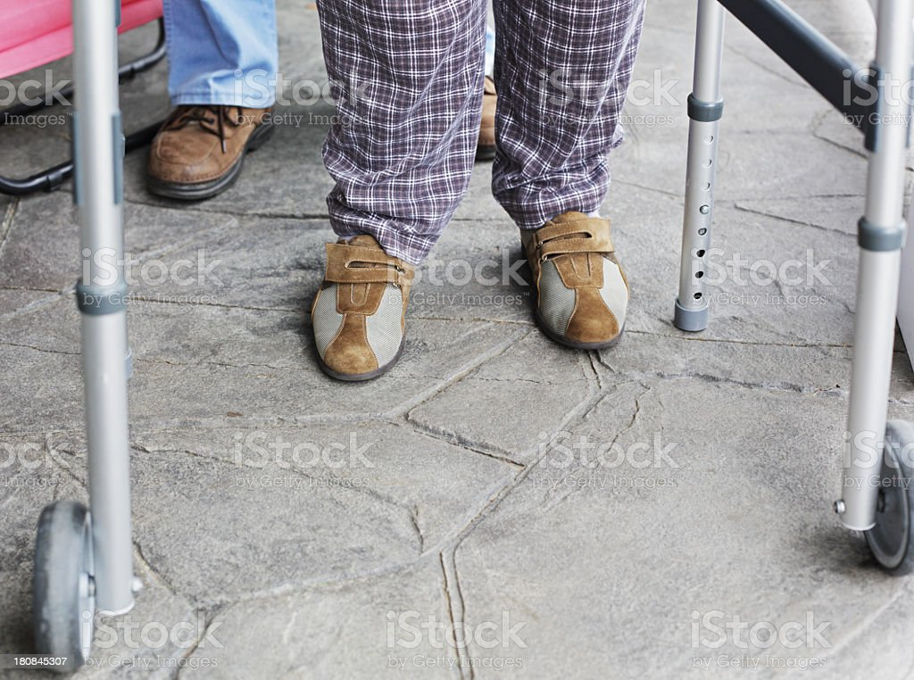 Senior Couple Shoes And Orthopedic Walker royalty-free stock photo