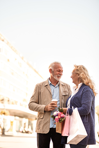 Senior couple shopping and having coffee in the city