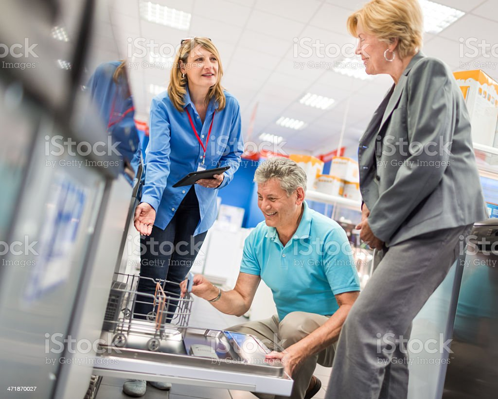 Senior Couple Shopping In Appliance Store royalty-free stock photo
