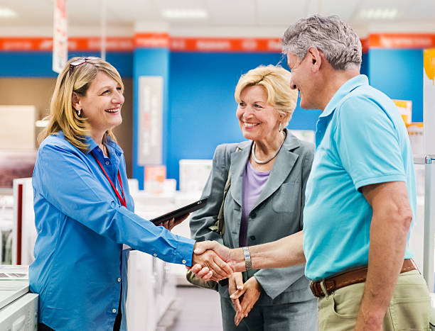 senior couple shopping in appliance store - commercial dishwasher stock photos and pictures