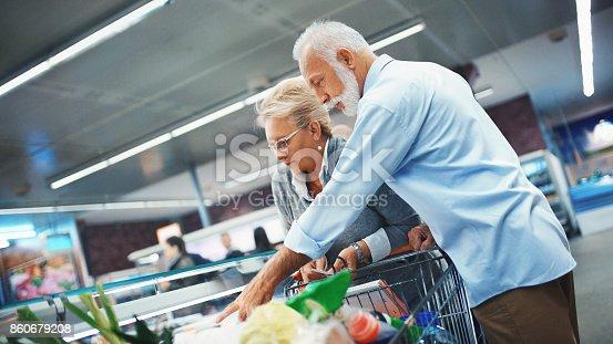 istock Senior couple shopping in supermarket. 860679208