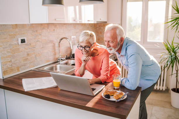 senior couple shopping online - baby boomers stock pictures, royalty-free photos & images