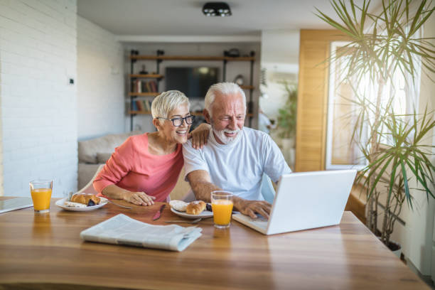 senior couple shopping online - electronic banking stock pictures, royalty-free photos & images