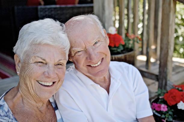 senior couple showing affection stock photo