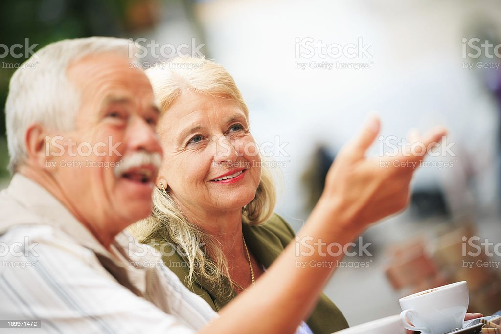 senior couple sitting in a cafe royalty-free stock photo