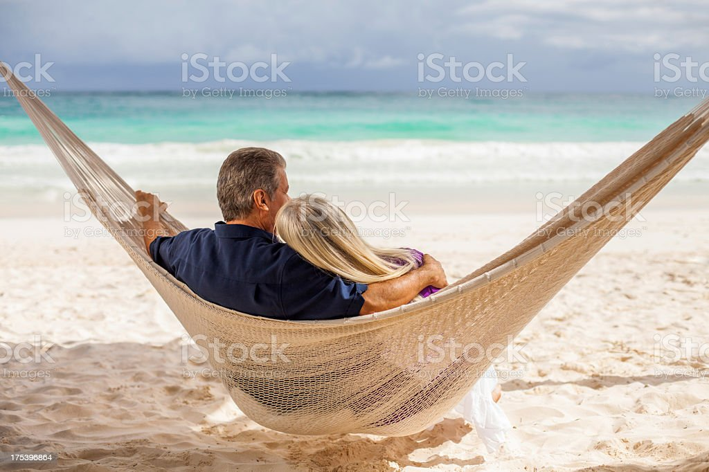 Senior couple sitting in a hammock royalty-free stock photo