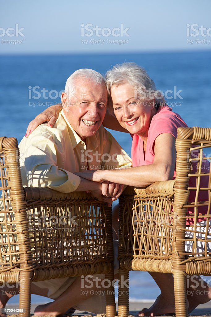 Senior Couple Sitting In Chairs Relaxing On Beach royalty-free stock photo