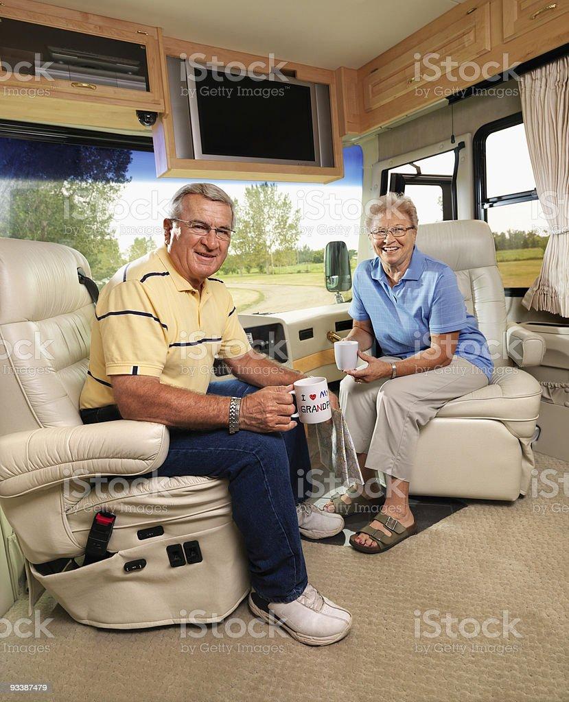 Senior couple sitting in RV. royalty-free stock photo