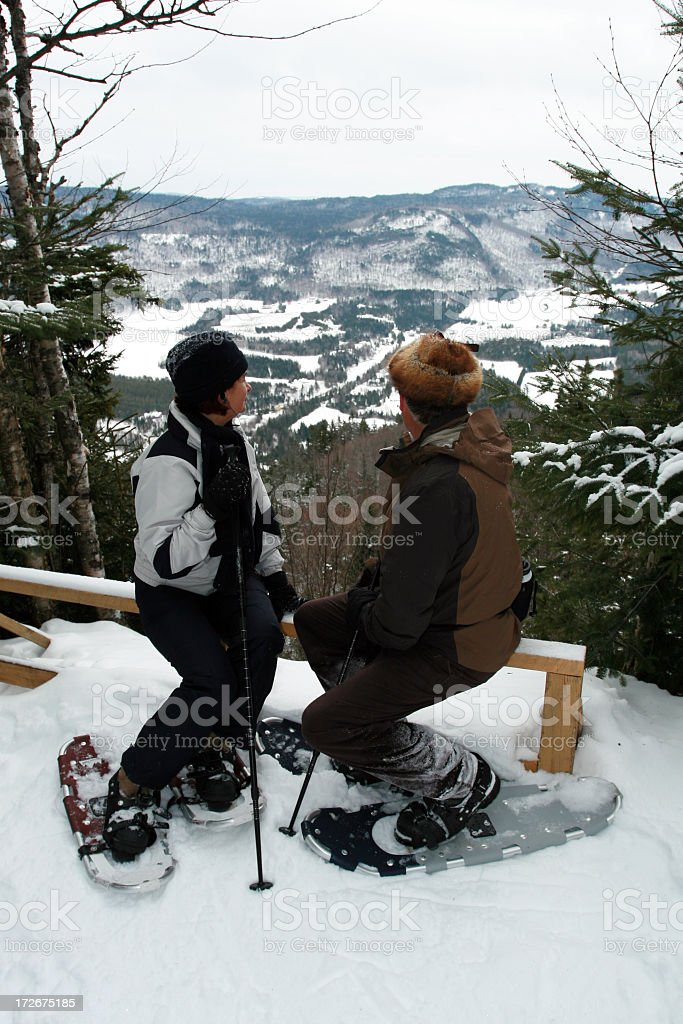 Senior Couple Sitting in Snowshoe Trail royalty-free stock photo