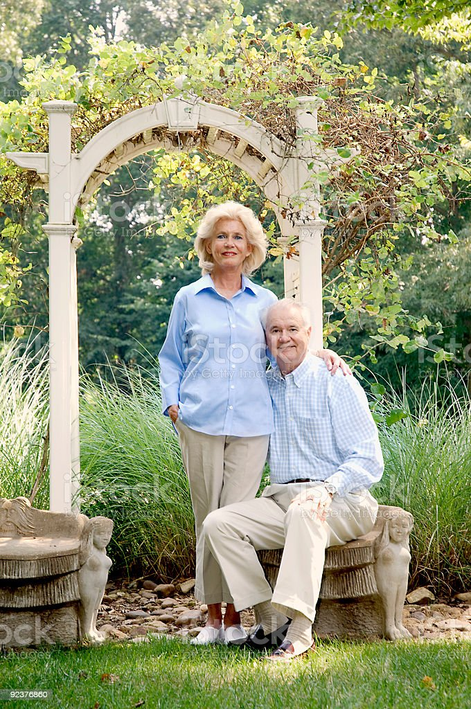 Senior Couple Sitting In the Garden royalty-free stock photo
