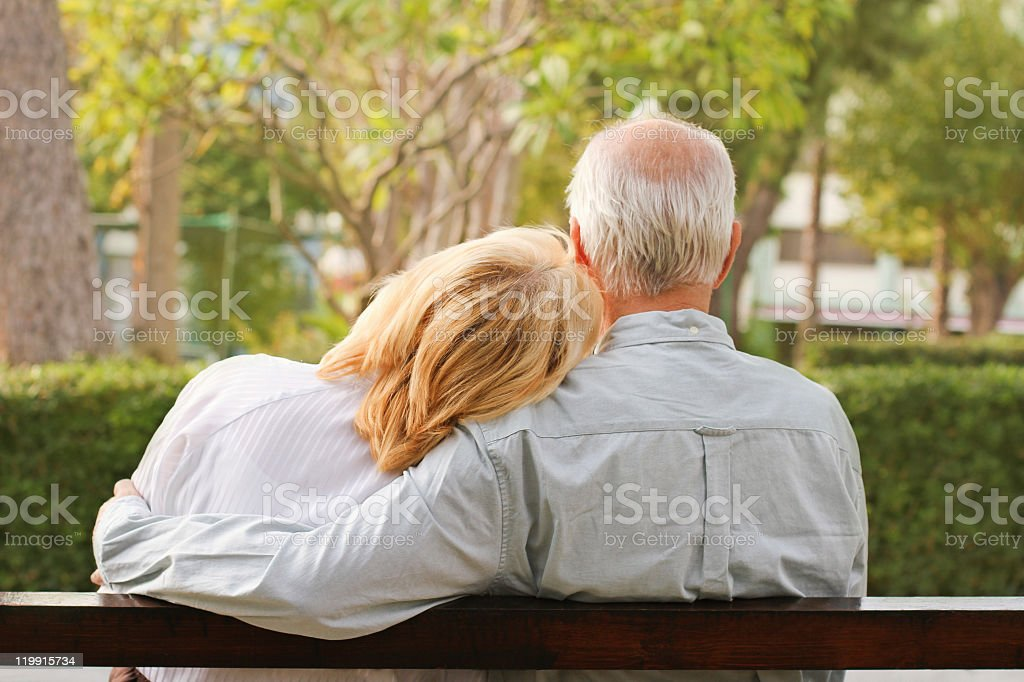 Senior couple sitting in the park royalty-free stock photo