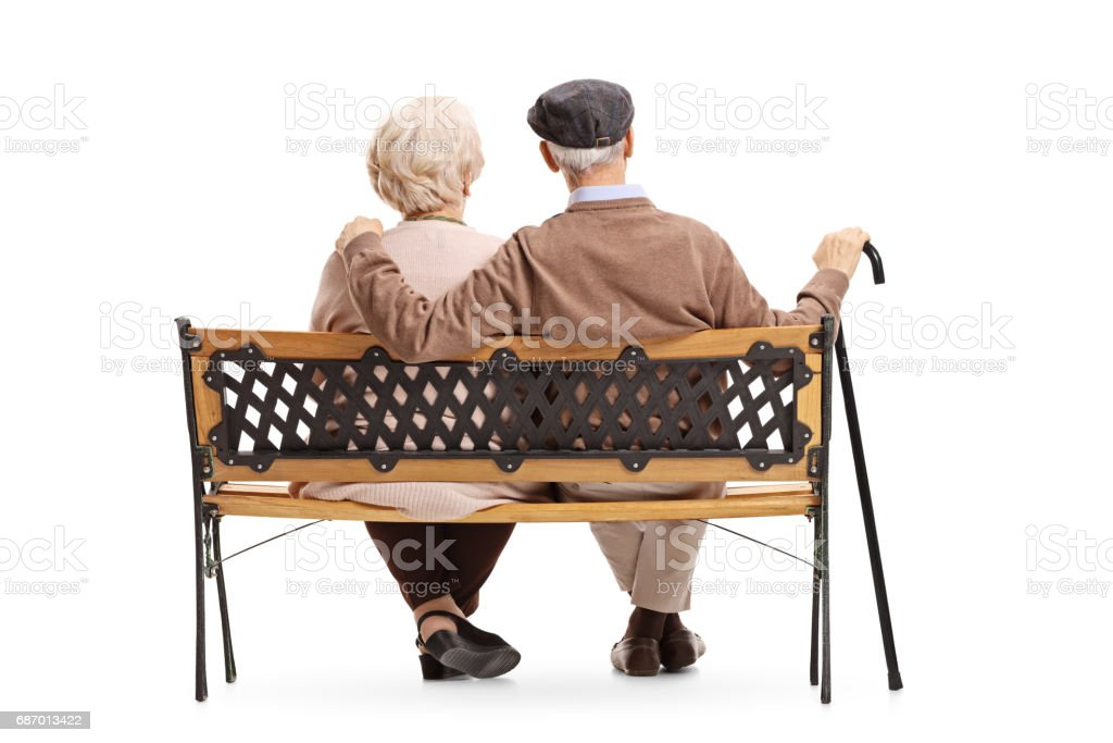 Senior couple sitting on a bench - foto de stock