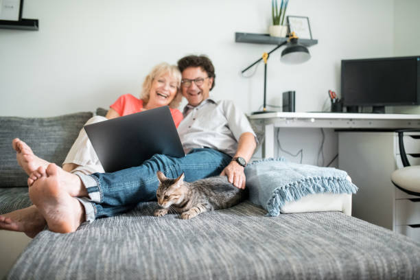 Senior couple sitting on the couch with their cat and using a laptop picture id1157582907?b=1&k=6&m=1157582907&s=612x612&w=0&h=psaccps yr995jugtnth18optychvua0i9wgaatgak0=