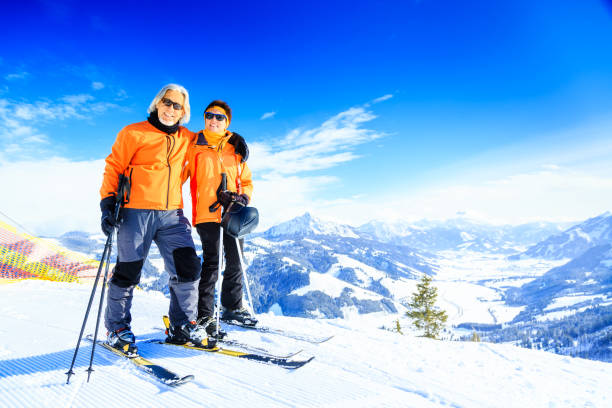 senior couple skiing stock photo