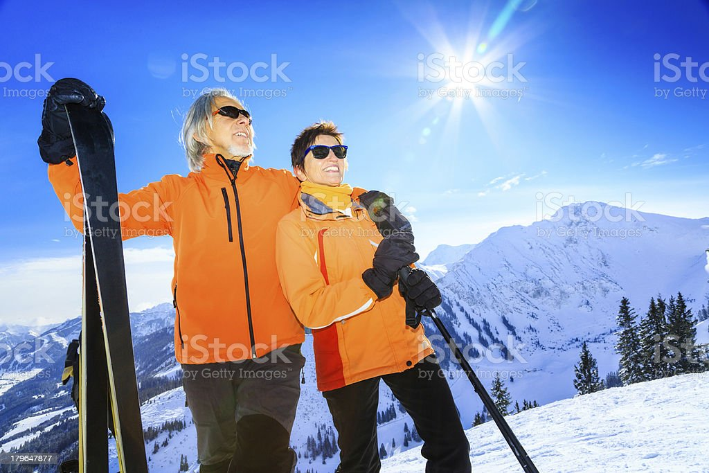 senior couple skiing royalty-free stock photo