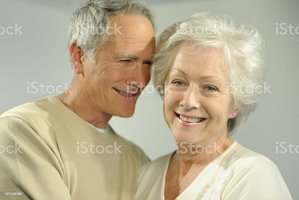 A senior couple smiles happily in a headshot. royalty-free stock photo