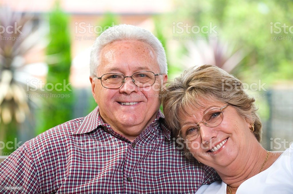 Senior couple smiling and showing affection royalty-free stock photo
