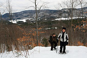 Two seniors in snowshoe trail