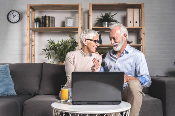Senior couple spending time together at home stock photo
