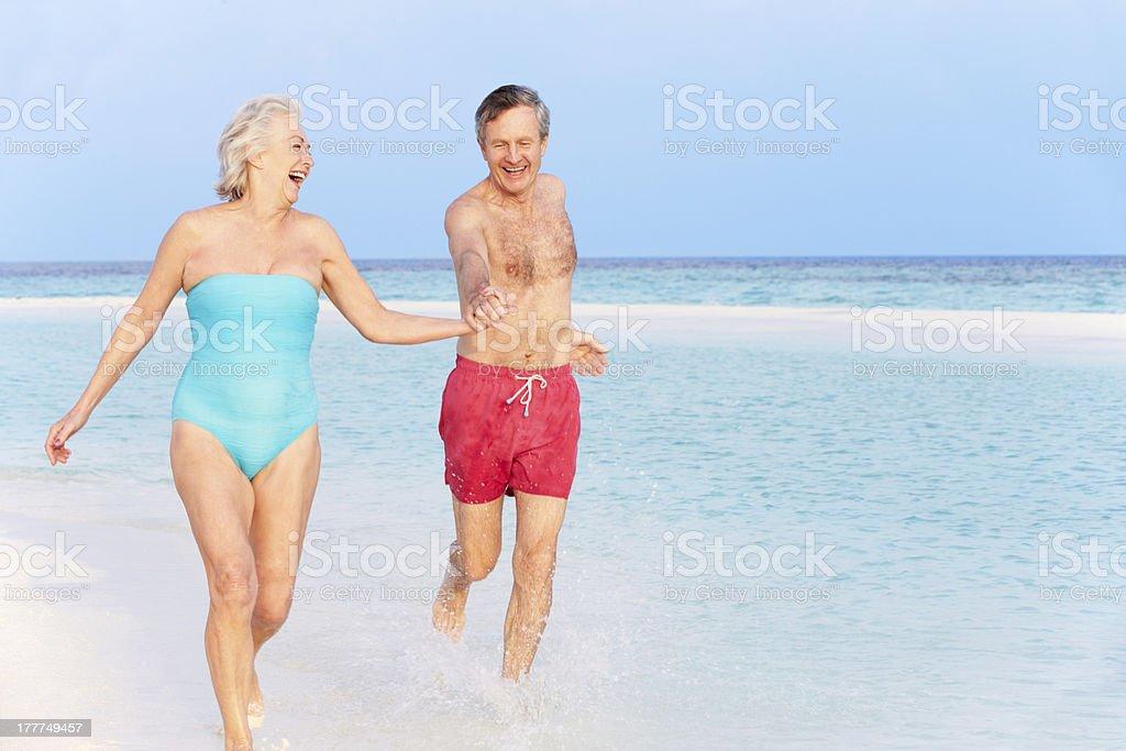 Senior Couple Splashing In Beautiful Tropical Sea royalty-free stock photo