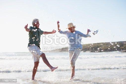 istock Senior couple splashing in ocean 116377246