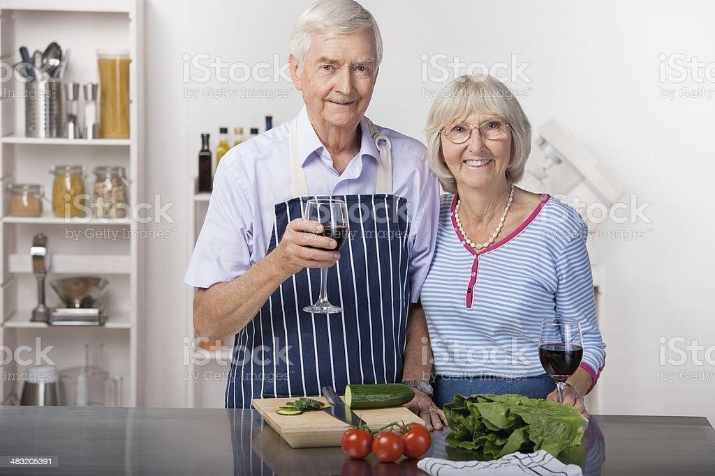 Senior Couple Taking A Break From Preparing A Salad royalty-free stock photo