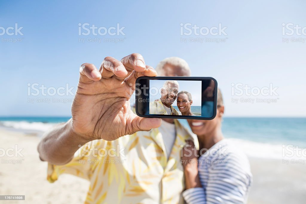 Senior couple taking a picture stock photo