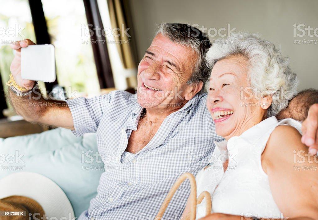 A senior couple taking a selfie royalty-free stock photo