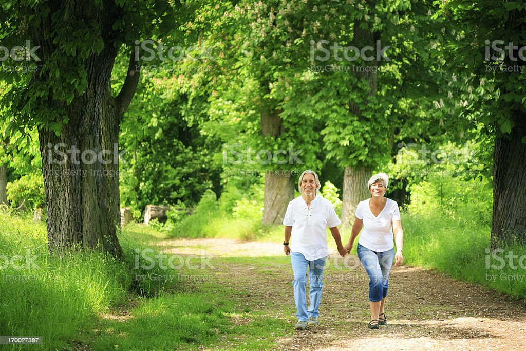 senior couple taking a walk royalty-free stock photo