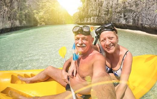Senior couple taking selfie on kayak in El Nido lagoon