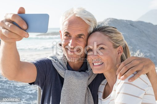 istock Senior Couple taking selfie 530589382