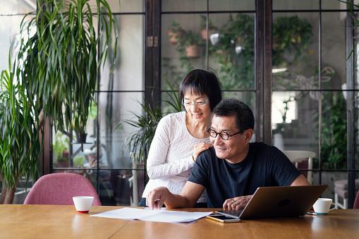 istock Senior couple talking about home finances 1149278789