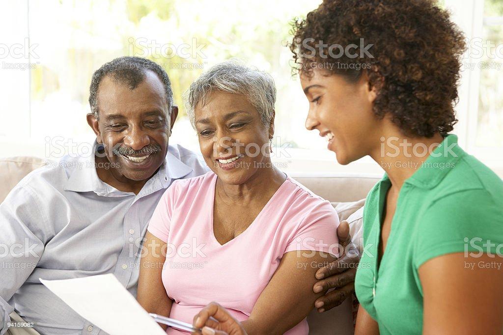 Senior Couple Talking To Financial Advisor stock photo