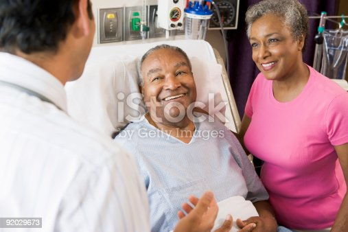 istock Senior Couple Talking with doctor 92029673