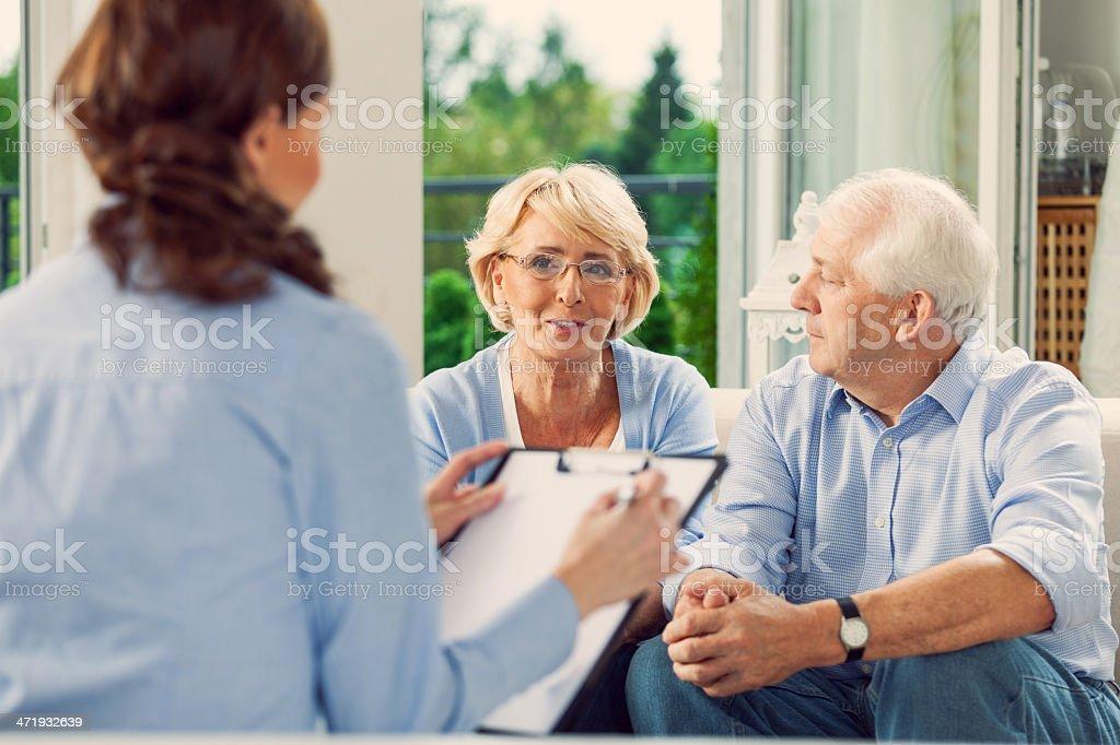 Senior Couple Talking With Insurance Agent Stock Photo ...