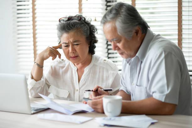 Senior Couple thinking about their Debts. stock photo