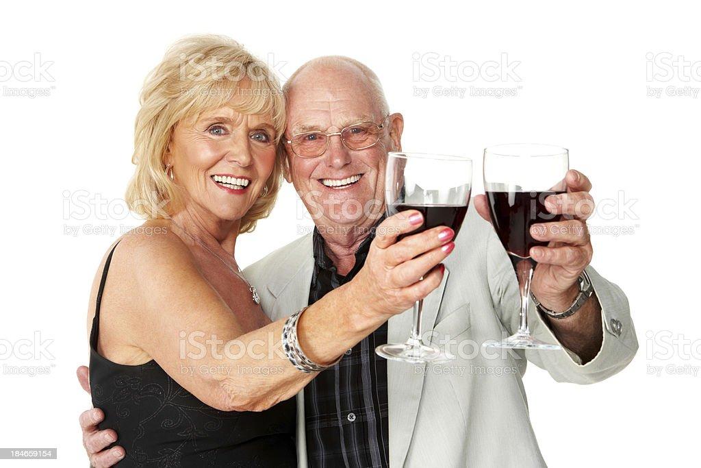 Senior Couple Toasting Wine - Isolated royalty-free stock photo