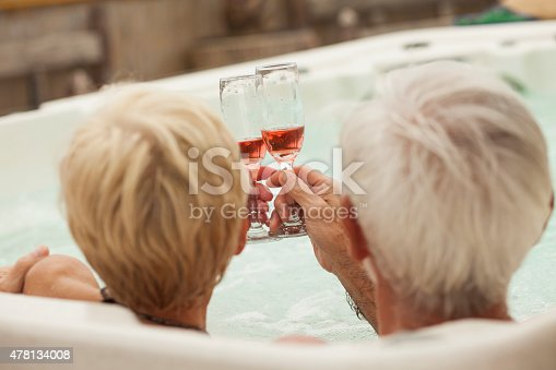 Senior Couple Toasting With Champagne In A Hot Tub Stock Photo ...