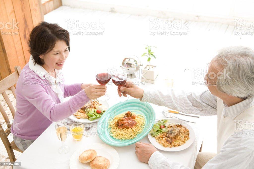 Senior couple toasting with wine royalty-free stock photo