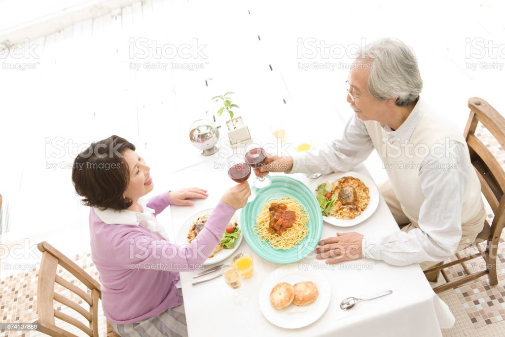 Senior couple toasting with wine royalty-free stock photo