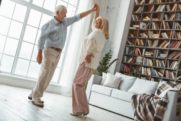 Senior couple together at home retirement concept dancing active picture id1168405877?b=1&k=6&m=1168405877&s=612x612&w=0&h=jb7uameu80eg9wi zl06ldlqo8zbeb5vbdcaglu2xfs=