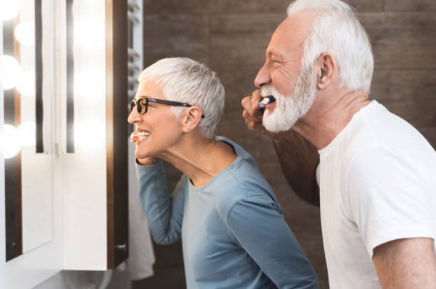 Senior couple  together in the bathroom stock photo