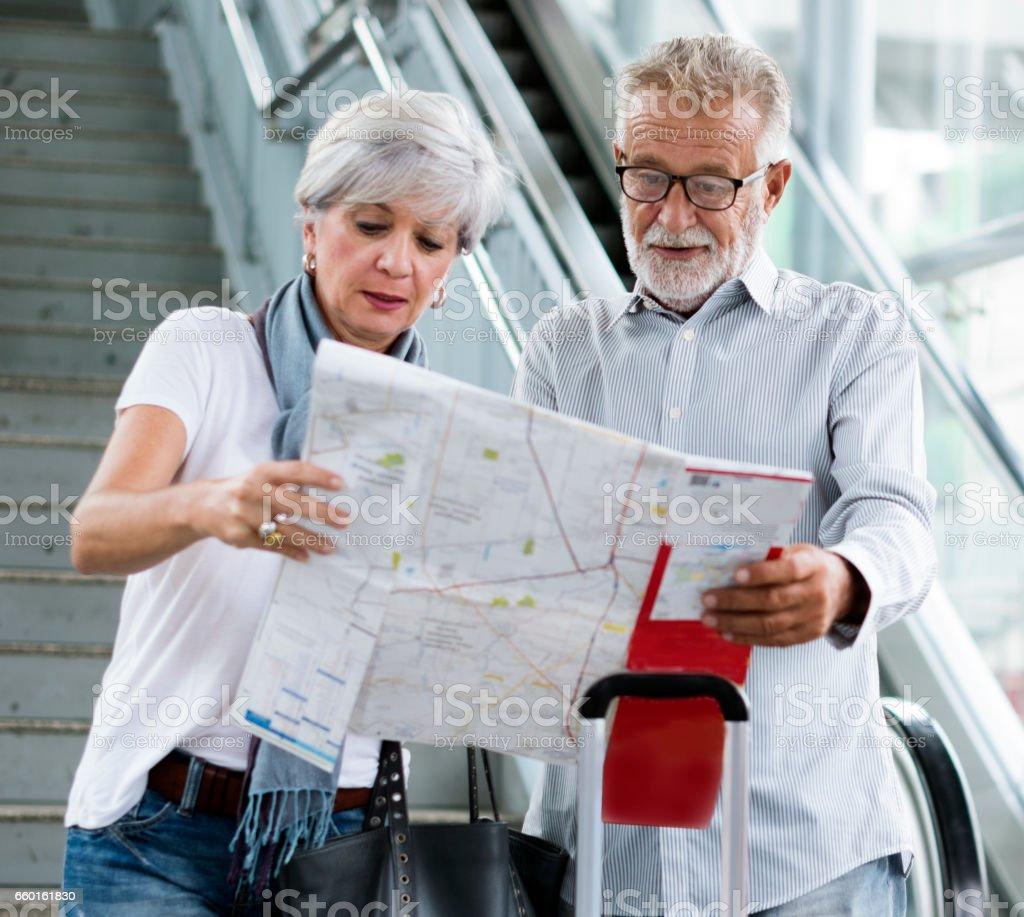 Senior couple tourists traveling city stock photo
