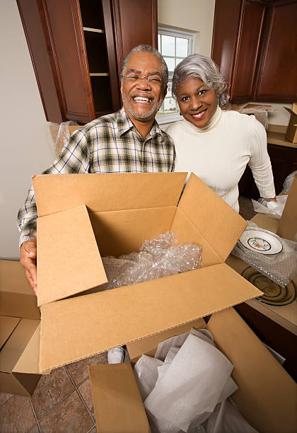 Senior couple unpacking boxes. stock photo